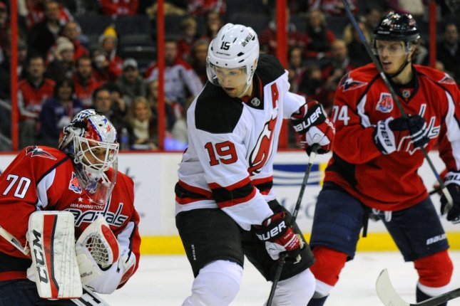 Former New Jersey Devils center Travis Zajac (19), shown Nov. 14, 2014, played all but 13 of his 1,037 career games with the Devils. File Photo by Mark Goldman/UPI