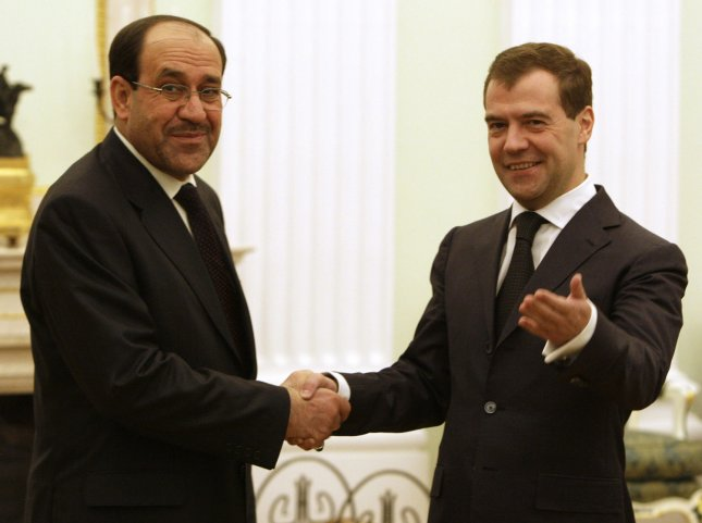 Russian President Dmitry Medvedev (R) welcomes Iraqi Prime Minister Nouri al-Maliki before their meeting in the Kremlin in Moscow on April 10, 2009. Both countries will consider restoring contracts they agreed to before the U.S.-led invasion of Iraq in 2003. (UPI Photo/Anatoli Zhdanov)