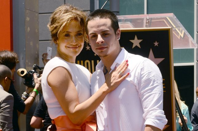 Singer and actress Jennifer Lopez poses with her partner Casper Smart during an unveiling ceremony honoring her with the 2,500th star on the Hollywood Walk of Fame in Los Angeles on June 20, 2013. UPI/Jim Ruymen
