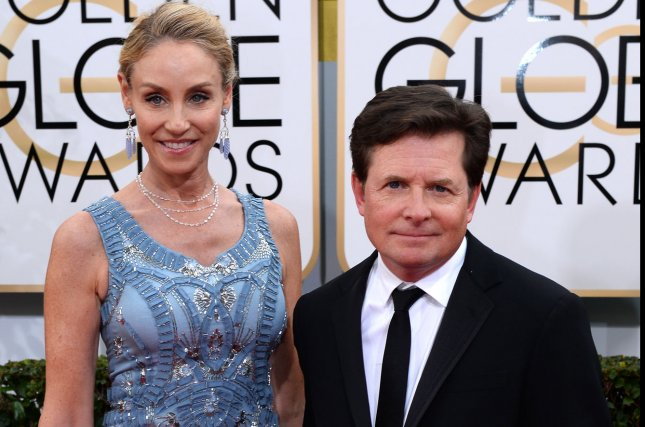 Actress Tracy Pollan (L) and actor Michael J. Fox arrive for the 71st annual Golden Globe Awards at the Beverly Hilton Hotel in Beverly Hills, California on January 12, 2014. UPI/Jim Ruymen