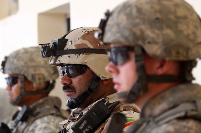 U.S. army soldiers stand alongside their Iraqi counterparts as they provide security at a marketplace in Baghdad's Abu Ghraib, Iraq on April 29, 2009. (UPI photo/Ali Jasim)