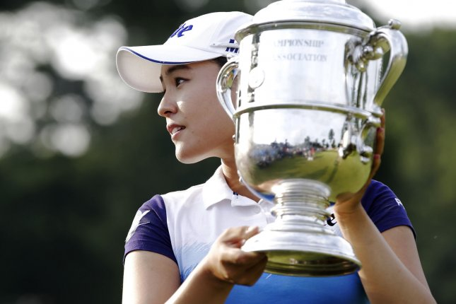 In Gee Chun of Korea holds up the championship trophy on the 18th green in the final round of the LPGA U.S. Women's Open Championship at Lancaster Country Club in Lancaster, PA on July 12, 2015. Chun wins the U.S. Women's Open and her first LPGA major championship with a score of 8 under par. Photo by John Angelillo/UPI