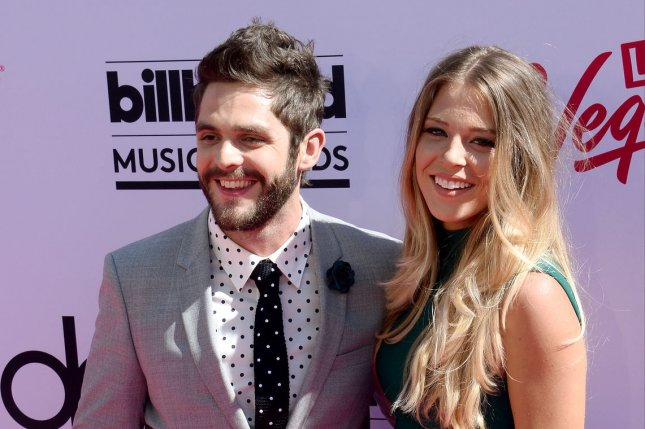 Thomas Rhett (L) and wife Lauren Akins at the Billboard Music Awards on May 22, 2016. File Photo by Jim Ruymen/UPI