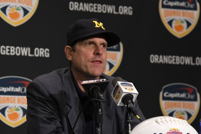 Michigan Wolverines head coach Jim Harbaugh answers questions from the media during the Orange Bowl Head Coaches press conference at the Renaissance Fort Lauderdale Cruise Port hotel on December 29, 2016 in Fort Lauderdale, Florida. File photo by Gary I Rothstein/UPI