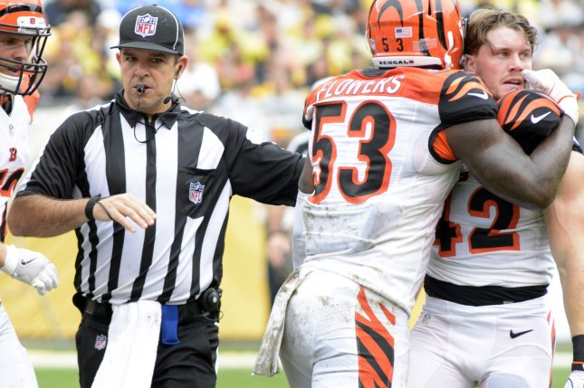 Former Cincinnati Bengals outside linebacker Marquis Flowers (53) restrains Cincinnati Bengals safety Clayton Fejedelem (42) who receives an penalty in the second quarter against the Pittsburgh Steelers on September 18 at Heinz Field in Pittsburgh, Pa. File photo by Archie Carpenter/UPI