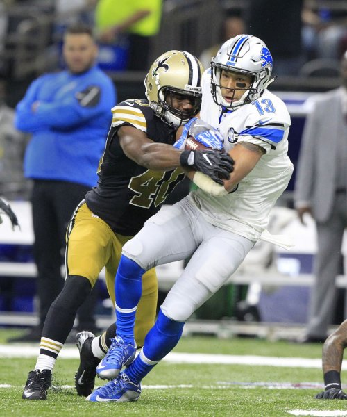 New Orleans Saints cornerback Delvin Breaux attempts to pry the ball lose from Detroit Lions receiver T.J. Jones during a game last season. Photo by AJ Sisco/UPI