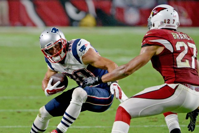 New England Patriots receiver Danny Amendola (L) picks up a first down to help set up the game winning field goal in the fourth quarter of the Patriots-Arizona Cardinals game at University of Phoenix Stadium in Glendale, Arizona, September 11, 2016. Moving in to make the stop is Cardinals Tyvon Branch. File photo by Art Foxall/UPI