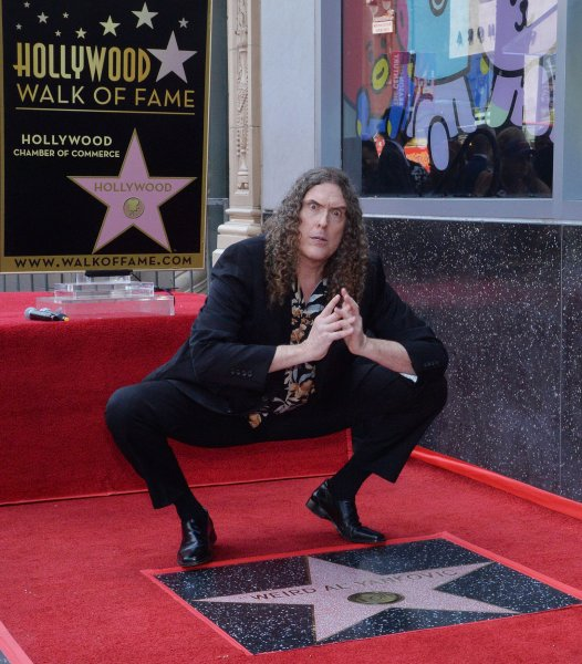 Grammy-winning musical satirist Weird Al Yankovic hams it up during an unveiling ceremony honoring him with the 2,643rd star on the Hollywood Walk of Fame in Los Angeles on Monday. Photo by Jim Ruymen/UPI