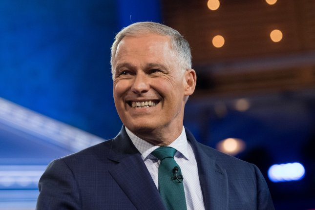 Washington Gov. Jay Inslee is introduced at the start of the Democratic presidential debates June 26 at the Knight Concert Hall in Miami, Fla. File Photo by Kevin Dietsch/UPI