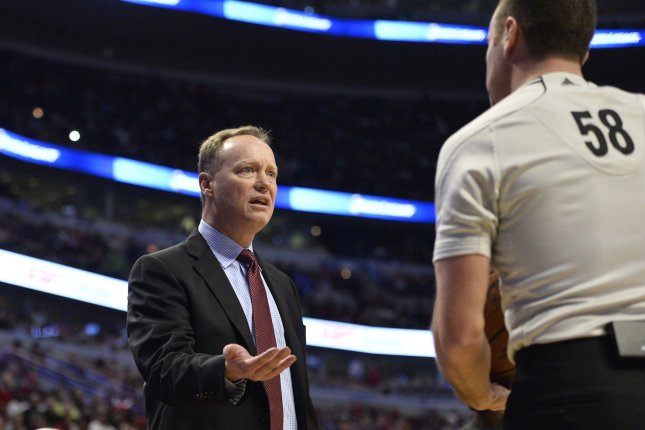Atlanta Hawks head coach Mike Budenholzer (L) talks with referee Josh Tiven during the first quarter against the Chicago Bulls at the United Center in Chicago on April 15, 2015. The Bulls defeated the Hawks 91-85. Photo by Brian Kersey/UPI