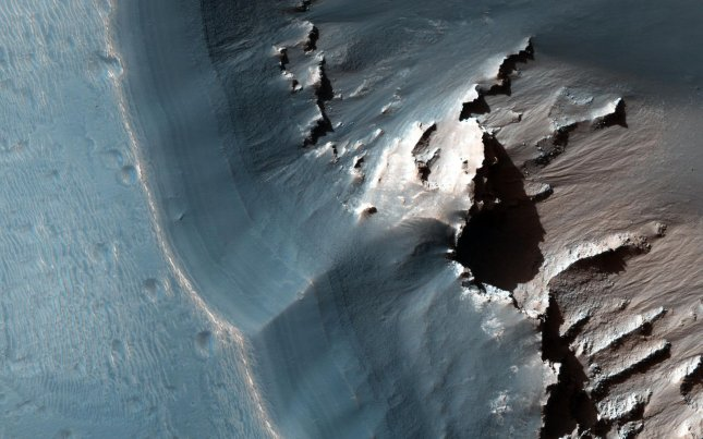 This image, acquired in November from NASA's Mars Reconnaissance Orbiter, shows the western side of an elongated pit depression on Mars. On Monday, South Korea announced a space agreement with the United States that could include joint exploration of Mars. File Photo courtesy of NASA