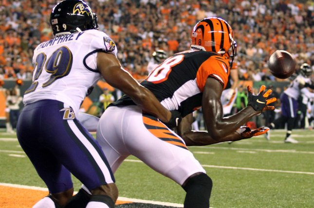 Cincinnati Bengals wide receiver A.J. Green (18) makes the touchdown catch under pressure from Baltimore Ravens defender Marlon Humphrey (29) during the first half of play on September 13 at Paul Brown Stadium in Cincinnati. Photo by John Sommers II/UPI