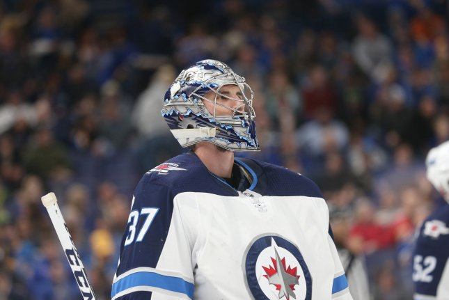 Winnipeg Jets goaltender Connor Hellebuyck skates to his bench at the end of the first period against the St. Louis Blues on February 23, 2018 at the Scottrade Center in St. Louis. Photo by Bill Greenblatt/UPI