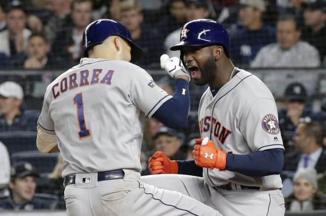 Houston Astros slugger Carlos Correa is congratulated by Yordan Alvarez (R) after hitting a three-run home run in the sixth inning of Game 4 of the American League Championship Series on Thursday at Yankee Stadium in New York City. Photo by John Angelillo/UPI