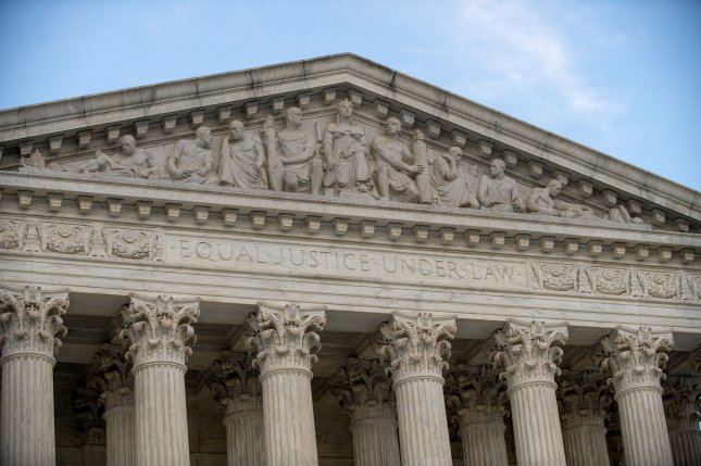The top of the U.S Supreme Court building says, Equal Justice Under Law on September 23 as the casket of late Associate Justice Ruth Bader Ginsburg lies in repose under the portico. Photo by Pat Benic/UPI