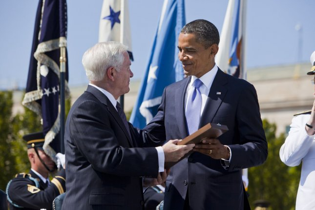 U.S. President Barack Obama awards Defense Secretary Robert Gates the Presidential Medal of Freedom during an Armed Forces Farewell Tribute in honor of Gates' departure at the Pentagon in Arlington, Virginia on June 30, 2011. Former CIA Director Leon E. Panetta will become the 23rd Secretary of Defense, replacing Gates on July 1. UPI/Jim Lo Scalzo/Pool