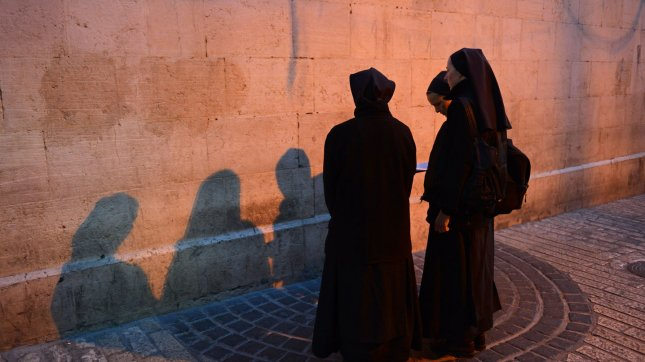 Catholic nuns pray at dawn on the Via Dolorosa, The Way of Suffering, believed to be the path that Jesus Christ carried his cross to be crucified on Good Friday in the Old City of Jerusalem, March 29, 2013. UPI/Debbie Hill