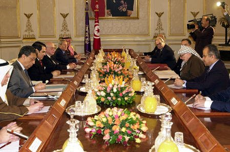 Top officials of countries in the Arab League, which was founded March 22, 1945, meet in Tunis, Tunisia, Jan. 11. 2001. They include Tunisian President Zine el-Abidine ben-Ali (3rd from left on left side of table) and Palestinian Liberation Organization Chairman Yasser Arafat (center, right side). The PLO was granted full membership in the league, which has 22 members, in 1976. rlw/Arafat Press Office/File/UPI