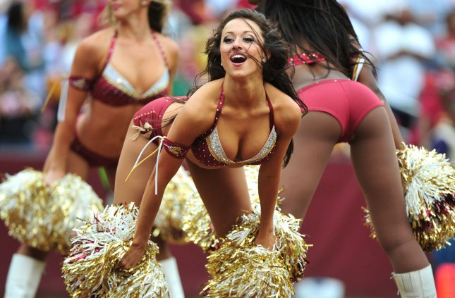 A Washington Redskins cheerleader performs against the Cardinals in 2011. The Detroit Lions will add a cheerleading team next season to to elevate our game-day entertainment. File photo by Kevin Dietsch/UPI