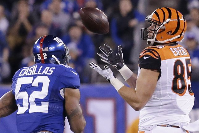 New York Giants' Jonathan Casillas defends Cincinnati Bengals' Tyler Eifert, who catches a pass for 71 yards in the first half against the New York Giants in week 10 of the NFL at MetLife Stadium in East Rutherford, New Jersey on November 14, 2016. Photo by John Angelillo/UPI