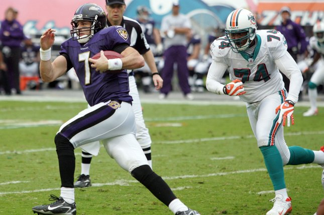 Baltimore Ravens quarterback Kyle Boller runs for an 11 yard gain in second quarter action with Miami Dolphins lineman Quentin Moses in pursuit at Dolphin Stadium in Miami on December 16, 2007. The Dolphins defeated the Ravens 22-16 in overtime for their first win of the season. (UPI Photo/Chad Cameron)