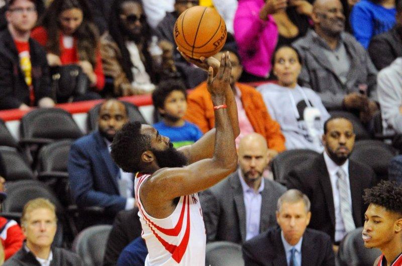 Houston Rockets guard James Harden (13) shoots a jumpshot. File photo by Mark Goldman/UPI