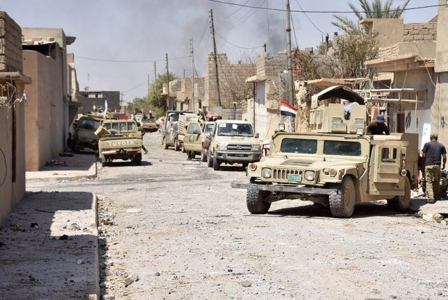 Iraqi troops take control of the town of Tal Afar, west of Mosul, after the Iraqi government announced an operation to retake it from the Islamic State in August. Government forces uncovered a mass grave containing the bodies of 40 suspected militant fighters. File Photo by Ali Bayaty/UPI
