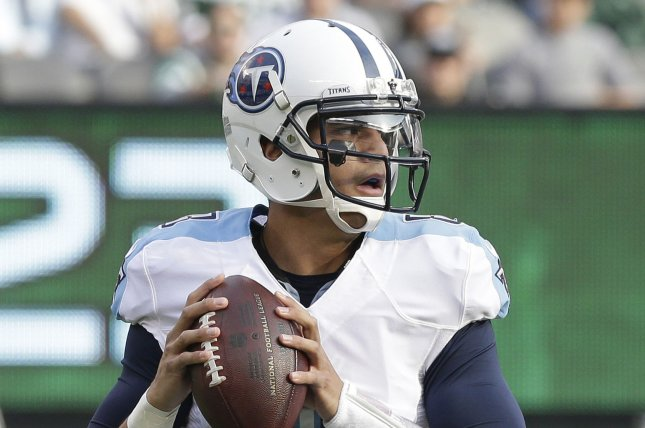 Tennessee Titans Marcus Mariota gets set to throw a pass in the first half against the New York Jets at MetLife Stadium in East Rutherford, New Jersey on December 13, 2015. File photo by John Angelillo/UPI