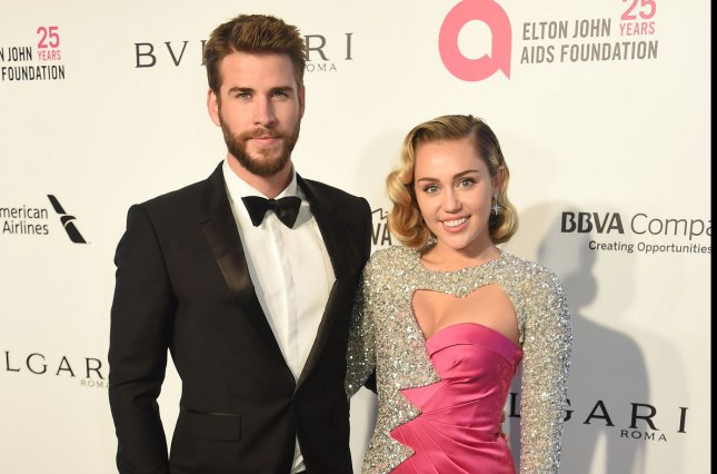 Miley Cyrus (R) and Liam Hemsworth attend the Elton John AIDS Foundation Academy Awards viewing party on Sunday. Photo by Gregg DeGuire/UPI