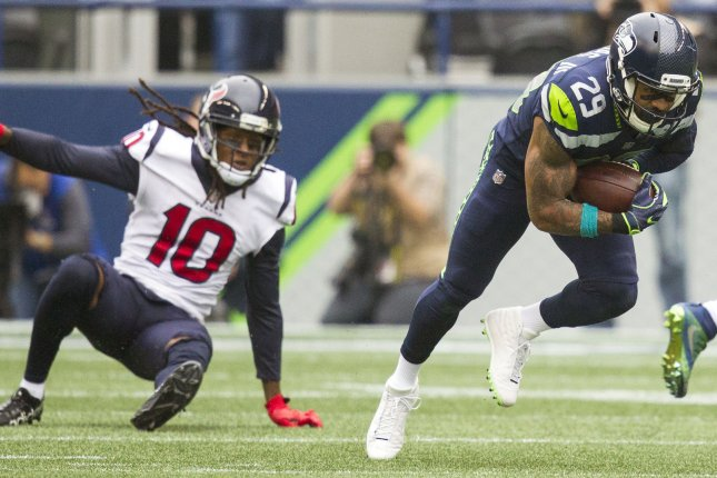 Seattle Seahawks free safety Earl Thomas (29) intercepts a pass and takes off running during a game against the Houston Texans last season. Photo by Jim Bryant/UPI