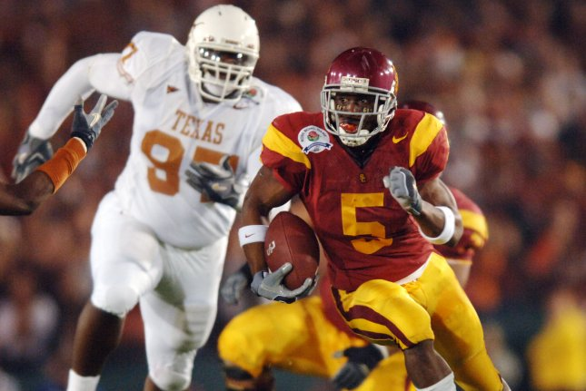 Former University of Southern California tailback Reggie Bush (5) scored 19 touchdowns during his final season with the Trojans. Bush was the No. 2 overall pick in the 2006 NFL Draft. File Photo by Michael Tweed/UPI
