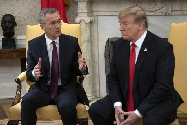President Donald Trump, R, met with NATO Secretary General Jens Stoltenberg, on April 2, 2019. It was established this week that under a new formula, the U.S. contribution to NATO will decrease. The decision comes a week before a NATO summit in London. File Photo by Ron Sachs/UPI