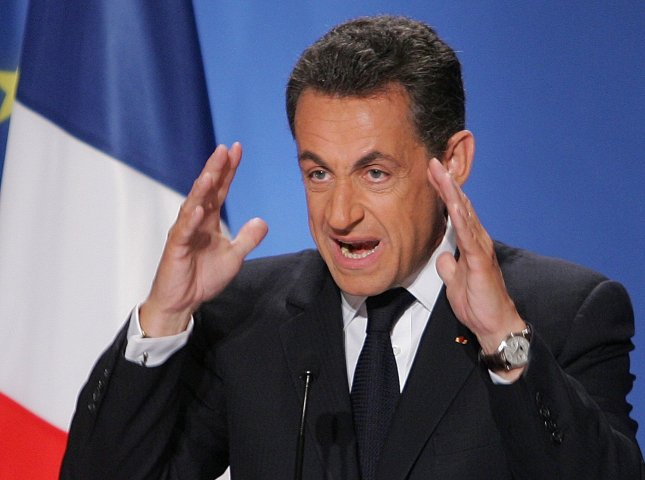 French President Nicolas Sarkozy gestures as he speaks during a press conference at the Elysee Palace in Paris, January 8, 2008. Sarkozy said his relationship with Italian singer and former model Carla Bruni was serious but he dodged giving a wedding date. (UPI Photo/Eco Clement)