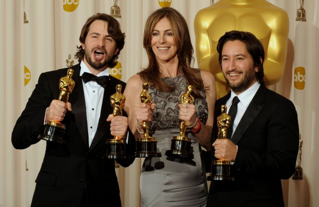 Best motion picture winners Mark Boal (L), Kathryn Bigelow (C) and Greg Shapiro of the film The Hurt Locker, hold their Oscars backstage at the 82nd annual Academy Awards in Hollywood, March 7, 2010. UPI/Jim Ruymen
