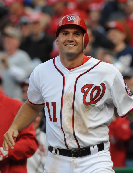 Washington Nationals Ryan Zimmerman smiles after scoring the winning run in the bottom of the 10th inning on a wild pitch by Alfredo Simon of the Cincinnati Reds at Nationals Park on April 12, 2012 in Washington, DC. The Nationals won 3-2. UPI/Pat Benic