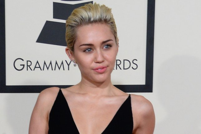 Recording artist Miley Cyrus is trying to help homeless LGBT youth. Photo by Jim Ruymen/UPI