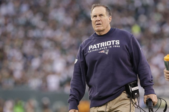 New England Patriots head coach Bill Belichick walks on the sidelines in the second half against the New York Jets at MetLife Stadium in East Rutherford, New Jersey on December 27, 2015. The Jets defeated the Patriots 26-20. Photo by John Angelillo/UPI