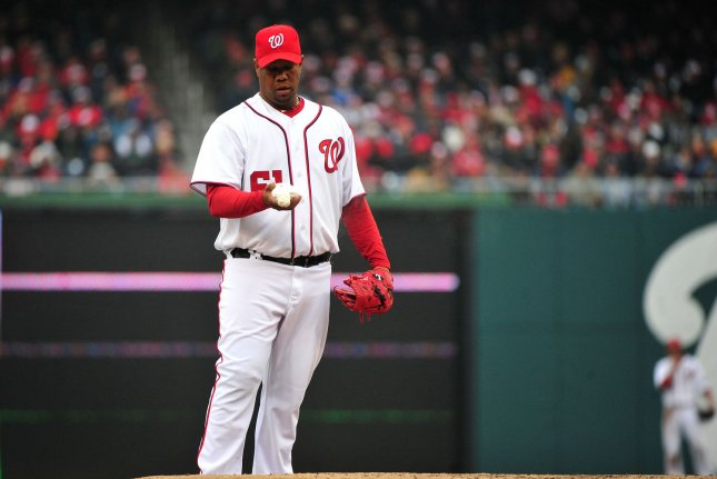 Former Washington Nationals pitcher Livan Hernandez prepares to pitch against the Atlanta Braves in the fourth inning at Nationals Park in Washington, March 31, 2011. File photo by Kevin Dietsch/UPI