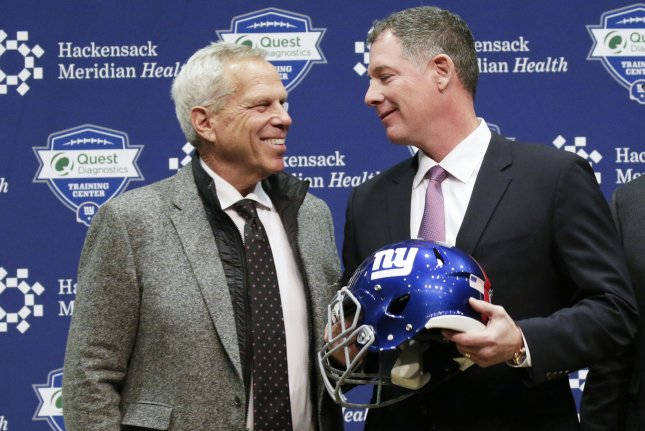 New York Giants co-owner Steve Tisch (L) and Giants head coach Pat Shurmur smile at a press conference on January 26, 2018 in East Rutherford, New Jersey. Photo by John Angelillo/UPI