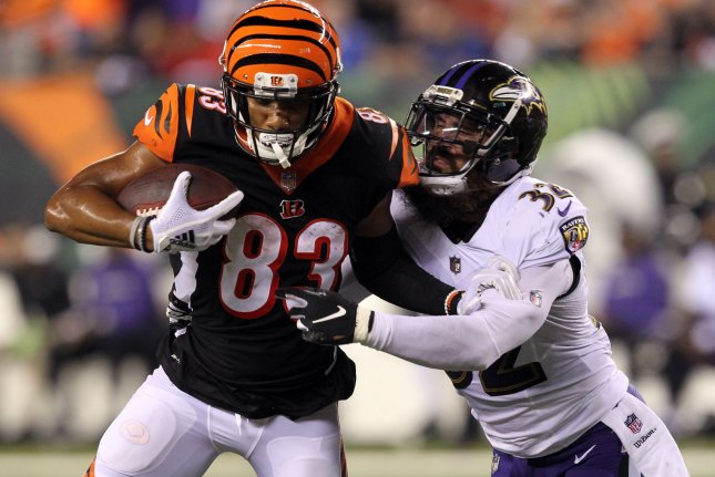 Cincinnati Bengals wide receiver Tyler Boyd (83) fights to break free from Baltimore Ravens safety Eric Weddle (32) during the first half of play on September 13, 2018 at Paul Brown Stadium in Cincinnati, Ohio. Photo by John Sommers II/UPI