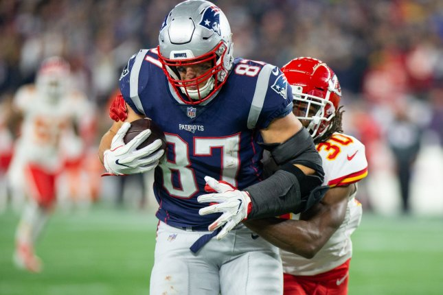 New England Patriots tight end Rob Gronkowski (87) is tackled by Kansas City Chiefs safety Josh Shaw (30) on a 39-yard reception late in the fourth quarter on October 14 at Gillette Stadium in Foxborough, Mass. Photo by Matthew Healey/UPI