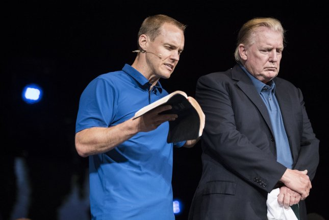 President Donald Trump makes a surprise visit to McLean Bible Church in Vienna, Va., where pastor David Platt (L) prayed for him on June 2. Photo by Sarah Silbiger/UPI