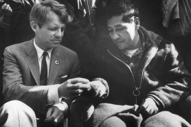 New York Sen. Robert F. Kennedy sits with United Farm Workers leader Cesar Chavez after a 23-day fast in 1966. The human rights award recognizes leaders who strive for ideals to better humanity. UPI Photo/File