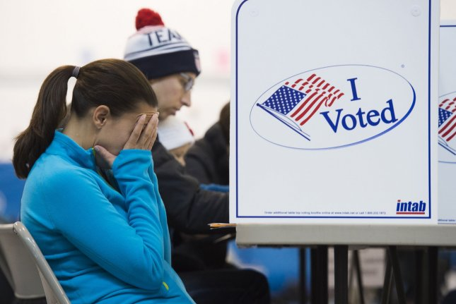 A frustrated voter sits at a voting booth in Alexandria, Va., on Election Day, November 8, 2016. Then-Republican candidate Donald Trump was elected president despite Democrat Hillary Clinton's winning the national popular vote by more than 3 million ballots. File Photo by Molly Riley/UPI
