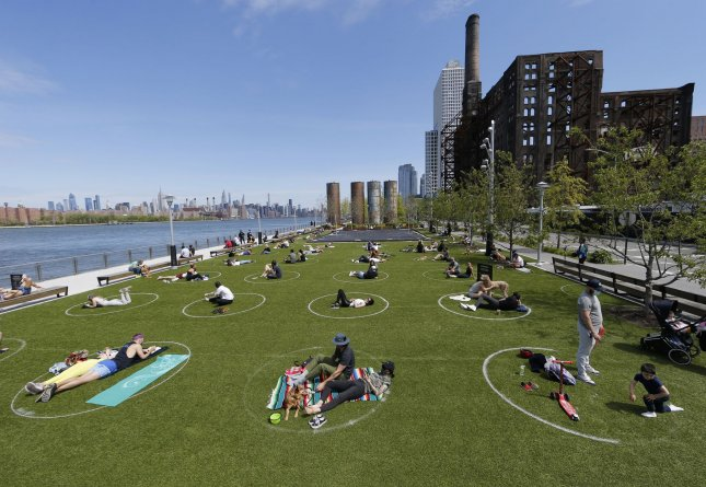 Officially designated social distancing circles are set up to prevent the spread of coronavirus in Domino Park in New York City in May. Photo by John Angelillo/UPI