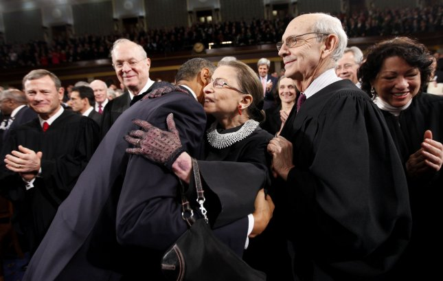 PresidPresident Barack Obama hugs Justice Ruth Bader Ginsburg on Capitol Hill in Washington, Tuesday, Jan. 25, 2011, prior to delivering his State of the Union address. From left are, Chief Justice John Roberts, Justice Anthony Kennedy, the president, Justice Ginsburg and Justice Stephen Breyer. UPI/Pablo Martinez Monsivais/POOL