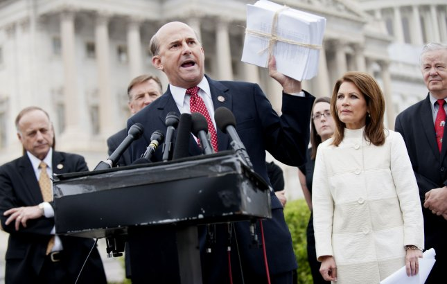 Rep. Louie Gohmert (R-TX) holds up a copy of President Obama's health care reform bill alongside Rep. Michele Bachmann (R-MN) and tea party supporters at a press conference on repeal of the bill on Capitol Hill in Washington, D.C. on March 21, 2012. UPI/Kevin Dietsch