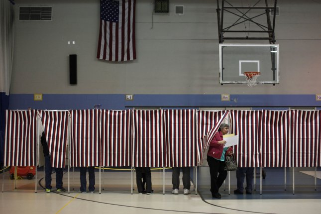A New Hampshire voter exits a polling booth after filling out her ballot for the midterm election inside the Bishop Leo E. Oneil Youth Center in Manchester, New Hampshire on November 4, 2014. Republican candidate for U.S. Senate Scott Brown is challenging New Hampshire Democratic incumbent Senator Jeanne Shaheen in today's elections. UPI/Matthew Healey