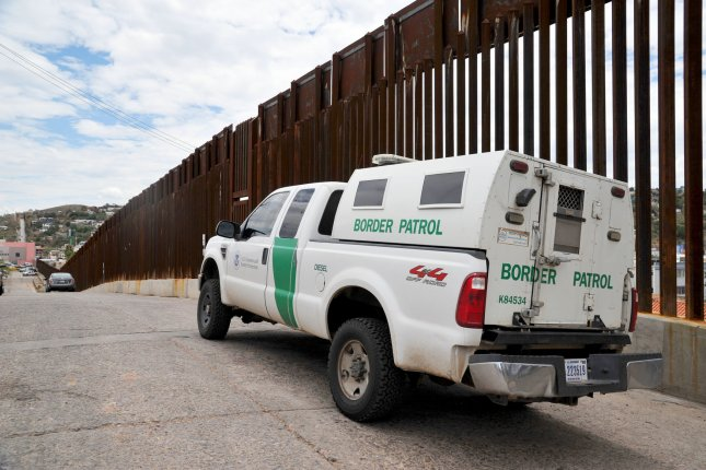 A United States Border Patrol truck sits next to the border fence between the United States and Mexico near Nogales, Arizona on July 13, 2014. More than 57,000 children from Central America have crossed the U.S. border alone since Oct. 1, 2013. President Obama has asked congress for $3.7 million to deal with the influx. File Photo by UPI/Art Foxall