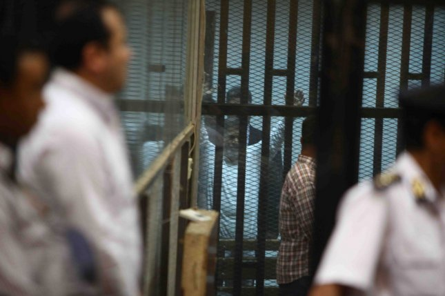 Egypt's former President Mohamed Morsi sits in the defendant's cage during his trial in Cairo, Egypt, on April 21, 2015. An Egyptian court sentenced Morsi to 20 years in prison without parole on Tuesday for the killing of protesters in Dec. 2012. Photo by Karem Ahmed/UPI